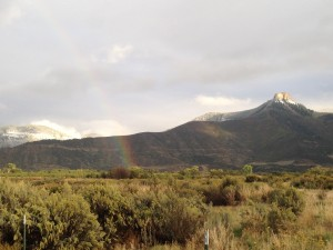 A rainbow over Battlement Mesa, the geological formation for which the community is named.